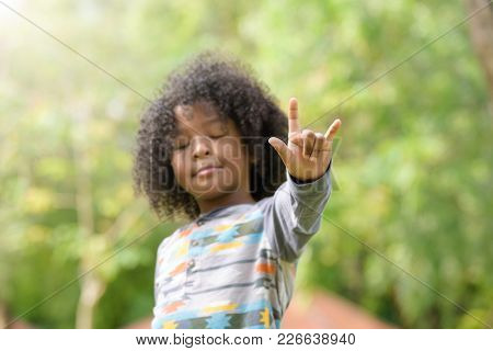 Mixed Race Boy Show I Love You Sign Language . Kids ,childhood Love Concept.