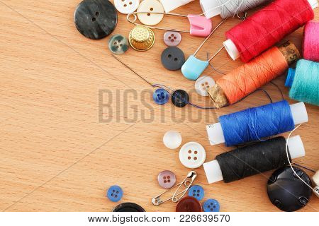 Photo Of Multi-colored Threads And Buttons On A Table Close-up