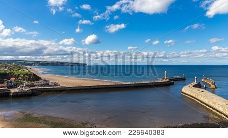 Whitby Pier And Beach, North Yorkshire, Uk
