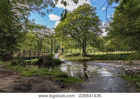 Flooded River Crossing And Footbridge Between Smardale And Crosby Garrett, Yorkshire Dales, Cumbria,
