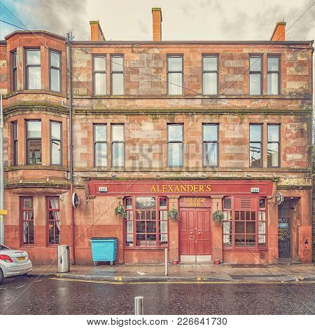 A Red Sandstone Tenement At The Bottom End Of Alexander Street In Clydebank With The Street Bar On T