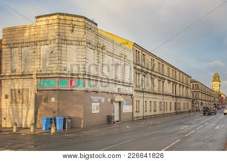 Clydebank, Scotland - January 20, 2018: A Sandstone Tenement Next To The Lucky Break Snooker Club On