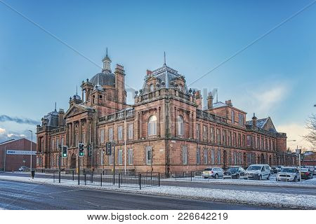 Glasgow, Scotland - January 17, 2018: Former Govan Town Hall Built With Red Sandstone.