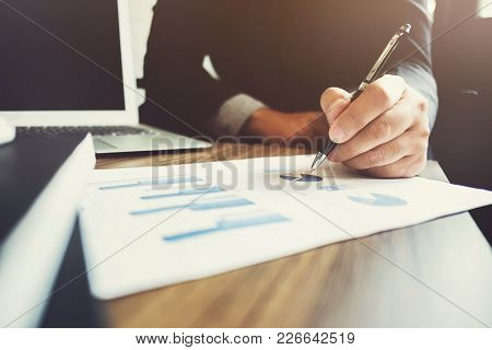 Business Man Pointing On Data Paper Working With Investment Data Or Company Growth Valuation, Select