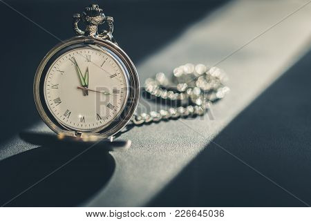 Vintage Pocket Watch On Chain On A Dark Background. Toned Photo