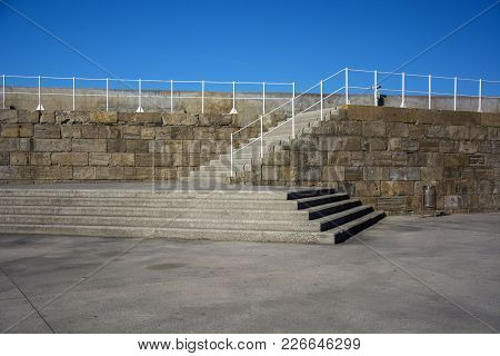 Photo Of A Stone Wall With Several Steps And Sunlight