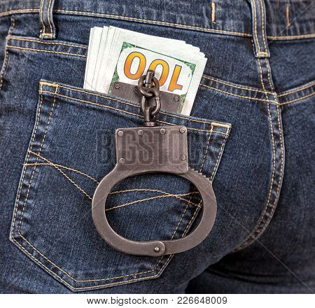 Police Metal Handcuffs And American Currency In Back Jeans Pocket