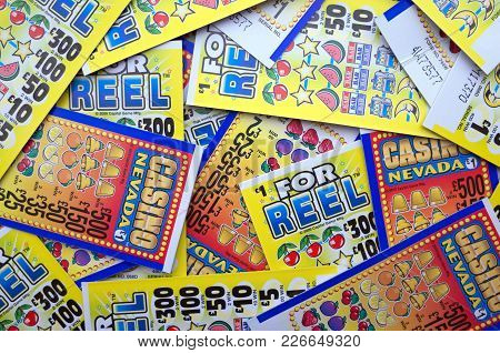 Bracknell, England - February 14, 2018: Random Selection Of Lottery Scratch Cards For Cash Prizes To