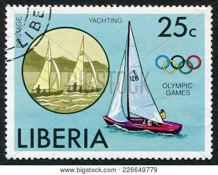 Liberia-circa 1972: Postage Stamps Printed In Liberia, Depicted The Olympic Symbol And A Yacht, Circ