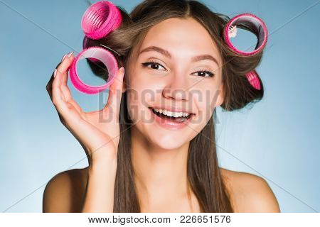 Happy Smiling Girl Going To A Party, Doing A Haircut With Curlers