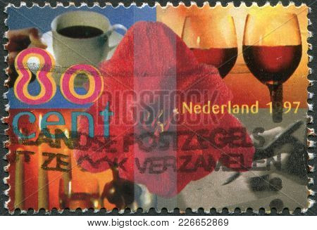 Netherlands - Circa 1997: A Stamp Printed In The Netherlands, Shows Amaryllis Surrounded By Cup Of C