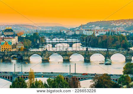 Prague, Czech Republic. Evening Cityscape In Sunset Time. Old Manes Bridge, Charles Bridge In Prague