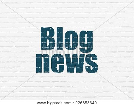 News Concept: Painted Blue Text Blog News On White Brick Wall Background