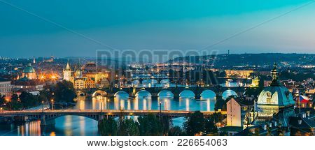 Prague, Czech Republic. Evening Panoramic View Of Evening Cityscape In Night Lighting. Charles Bridg