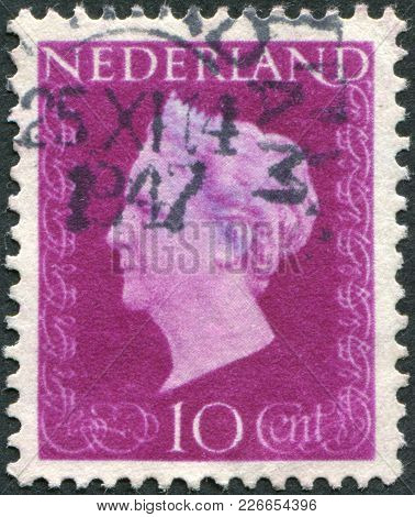 Netherlands - Circa 1947: A Stamp Printed In The Netherlands, Shows Wilhelmina Of The Netherlands, C