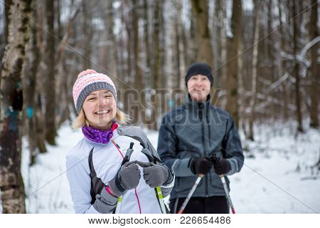 Image Of Cheerful Sports Woman And Man Skiing In Winter Forest During Day