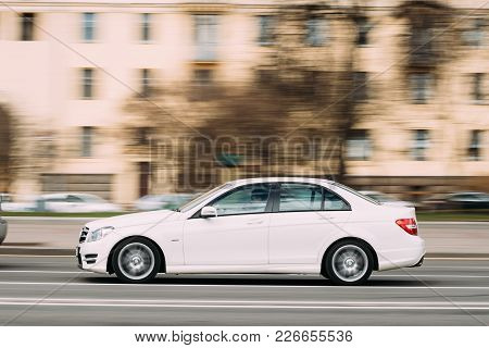 Minsk, Belarus - April 7, 2017: White Color Mercedes-benz C-class In Fast Motion On Street.