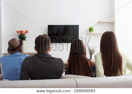 People Watching Tv, Friends Watching Tv, Company Sitting On Couch And Watching Television