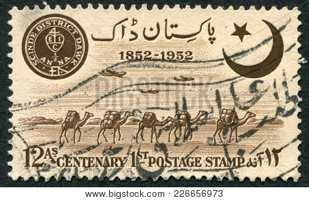 Pakistan - Circa 1952: A Stamp Printed In The Pakistan, Devoted To 100 Anniversary Of Indian Postage