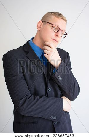 Closeup Portrait Of Thoughtful Young Business Man Looking Away And Touching Chin. Contemplation Conc