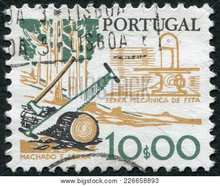 Portugal - Circa 1979: A Stamp Printed In The Portugal, Is Depicted Tool Woodcutter, Two-handled Saw