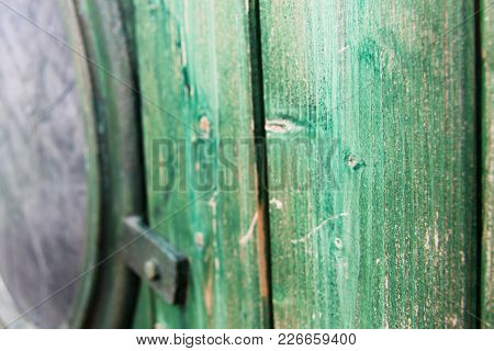 A Porthole Weathered And Old With A Touch Of Green