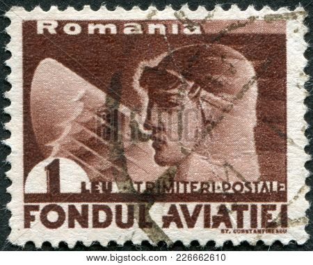 Romania - Circa 1936: A Stamp Printed In The Romania, Shows The Head Of The Pilot And The Wing Of An