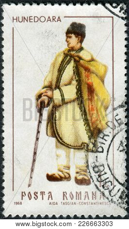 Romania - Circa 1968: A Stamp Printed In The Romania, Shows Regional Folk Costumes, A Man From Huned