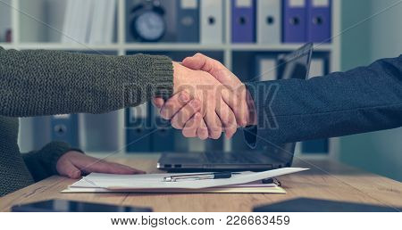 Man And Woman Shake Hands Over Business Agreement. Start Up Business Female Entrepreneur Making Hand