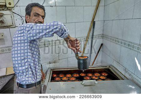 Tehran, Iran - April 28, 2017: Old Man Is Preparing Abgoosht, Traditional Iranian Dish, In A Cheap C