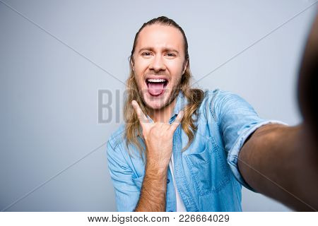 Self Portrait Of  Attractive, Crazy, Bearded Guy With Stubble, Long Hair Shooting Selfie And Showing