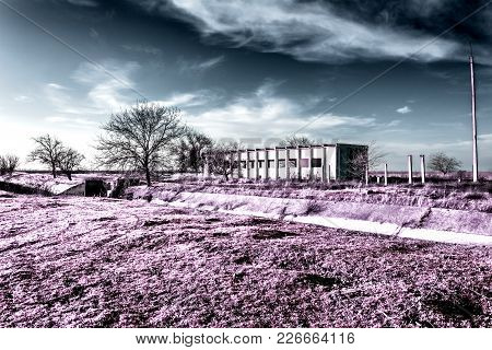 Abandoned Electric Station In Infrared Colors. Post-apocalyptic Infrared Landscape.