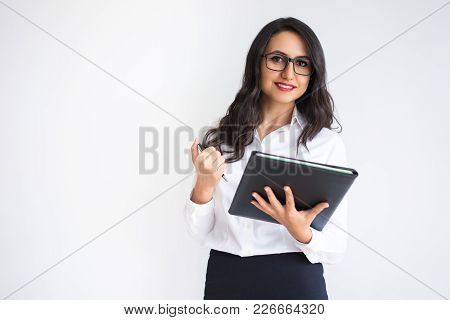 Closeup Portrait Of Smiling Young Beautiful Dark-haired Woman Looking At Camera And Holding Folder A