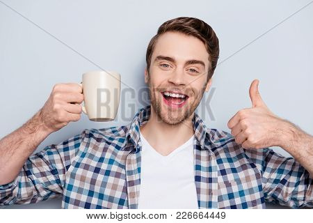 Close Up Portrait Of Cheerful, Happy, Smiling Guy In Checkered Shirt, Showing Cup Of Coffee And Thum