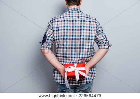Backside View Of Man Prepared Red Gift Box With White Ribbon On Holiday And Special Occasion, Isolat