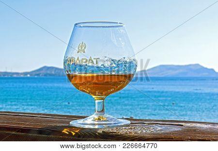 Novyy Svet, Crimea - September 2, 2017: A Glass Of Cognac On The Background Of The Sea. Novyy Svet,