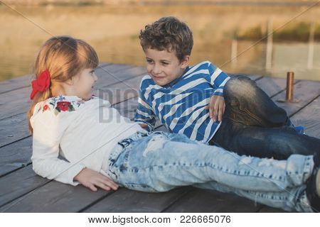 Girl And Boy Playing