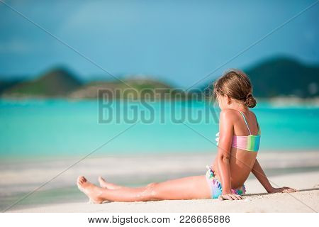 Adorable Little Sister At Beach During Summer Vacation
