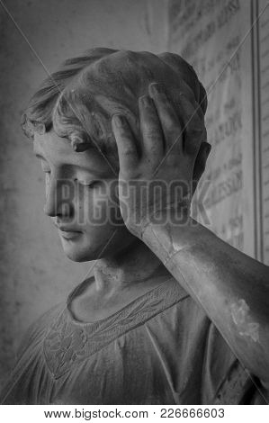 Forli, Italy - 27th December 2017: Worried Woman Statue Immersed In A Deep Thought
