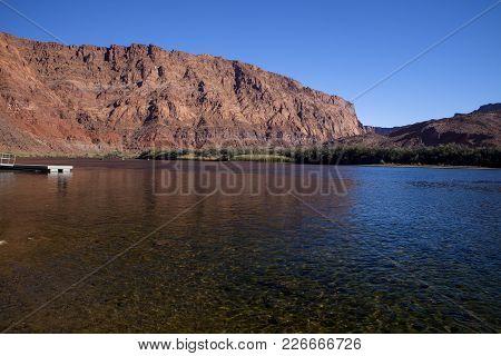 The Colorado River And The Vermilion Cliffs In Glen Canyon Arizona