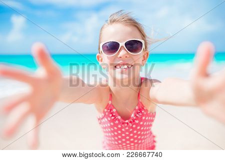 Happy Little Girl Taking Selfie At White Beach On Exotic Island