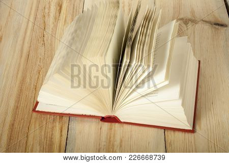 Open Book On Wooden Table. Education Concept. Back To School.copy Space For Text.