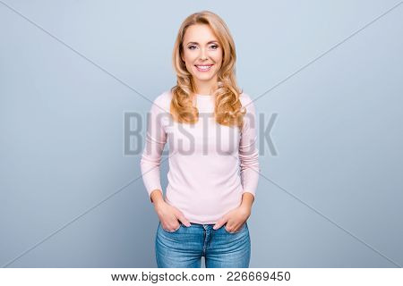 Attractive, Pretty, Perfect Woman With Beaming Smile In Casual Outfit Holding Hands In Pocket Standi