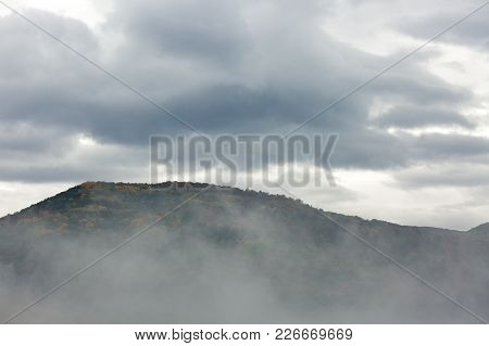 Weather, Mood, Fall Concept. Typical Autumn View In The Mountains, Under The High Hill Covered With