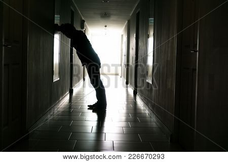 Silhouette Of Business Man Sitting Alone., Sad And Serious Male Sit And Hug His Knee Alone Of Closei