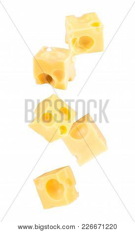 Falling Cubes Of Cheese Isolated On White.