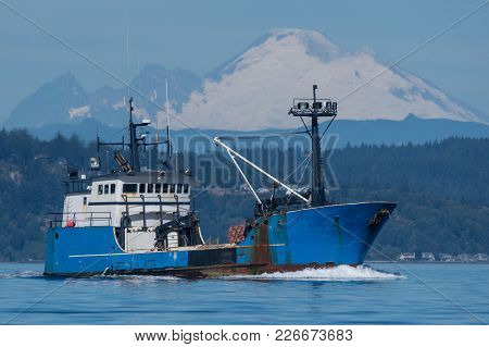 Fishing Boat Underway On Puget Sound With Mount Baker In Background