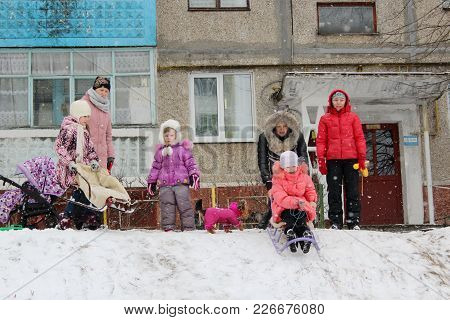 Chernihiv / Ukraine 08 February 2015: Town And Joy Children Are Sleding From The Hill. 08 February 2