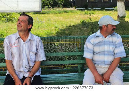 Chernihiv / Ukraine. 13 June 2015: Two Men With Different Looks And Objectives Have A Rest In The Op