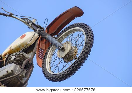 Motorcycle On The Pedestal. A Light Motorbike On A Pole, Put Up As A Dummy Or A Monument